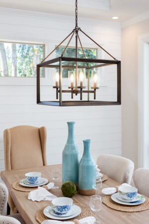 Dining Room Table And Pendant Light Fixture In New Luxury Home Is Set With