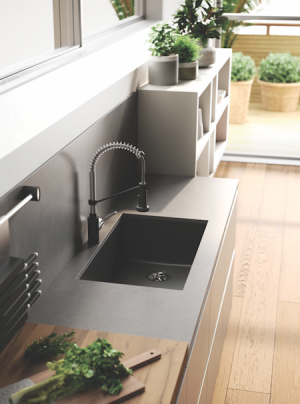 Thin showerheads and quartz sinks are two ways to incorperate modern interior design into any K&B space.