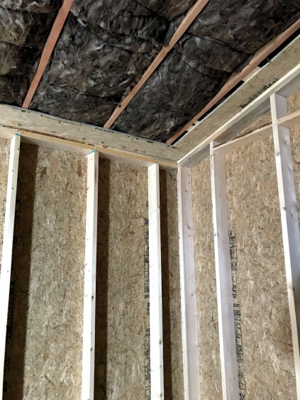 At the perimeter of the ceiling, the crew installed strips of OSB. The Vycor installed across the top plates adheres to the top of this OSB and drywall is secured to the bottom to complete the air barrier across the lid.