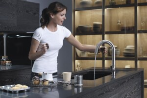Kohler's Sensate touchless faucet has intuitive Response®technology: a simple wave of a hand, or an object such as a pan or utensil, turns it on or off.