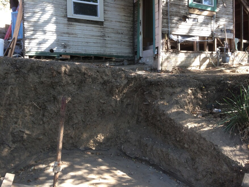 When Soil On Top Of The Concrete Garage Roof Downslope House Was