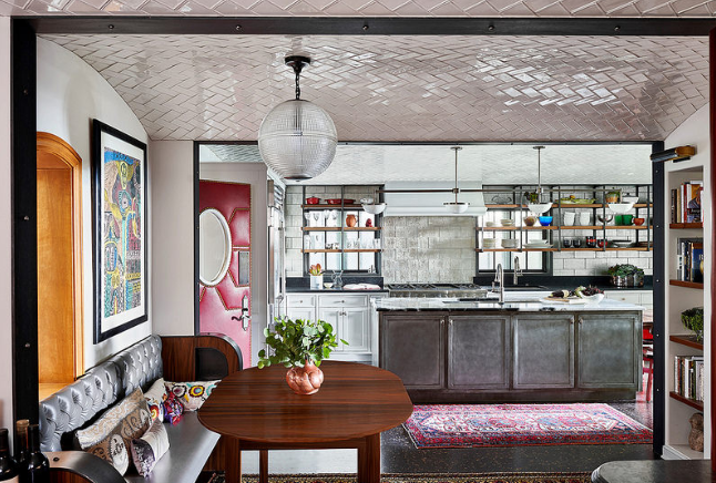 """In 2019, kitchens will be larger and include more expansive seating areas and living space, as well as """"unfitted"""" elements such as open shelving and furniture-like pieces."""