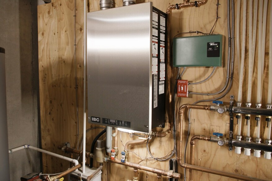 Because it uses radiant heating fed by a condensing propane boiler — which uses minimal electricity — the Boyd residence can use a smaller, more affordable standby generator.