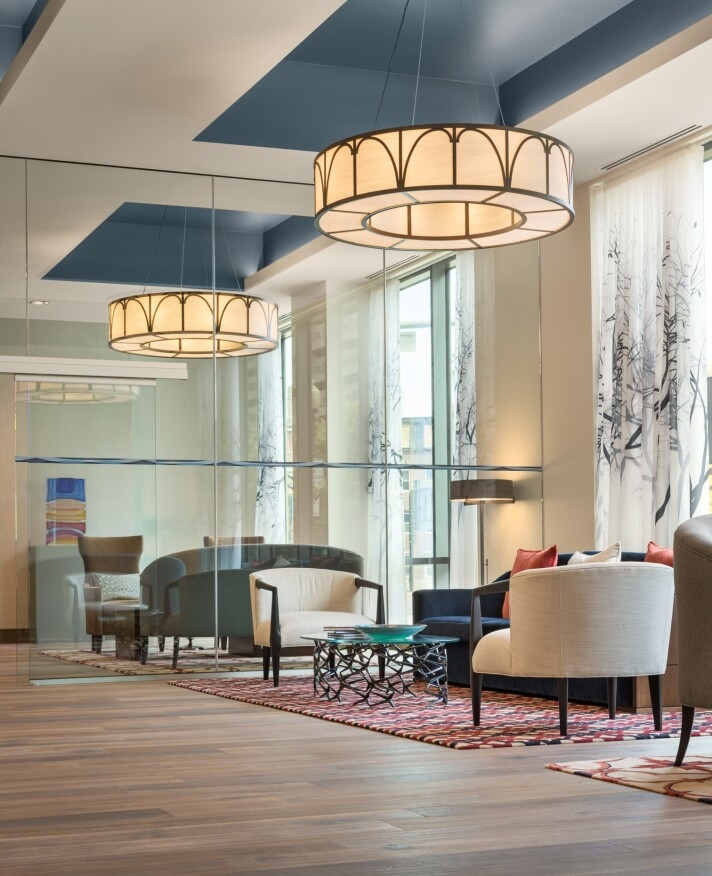 A multilevel lobby with glass lends a modern feeling to One Canal but  celebrates the old