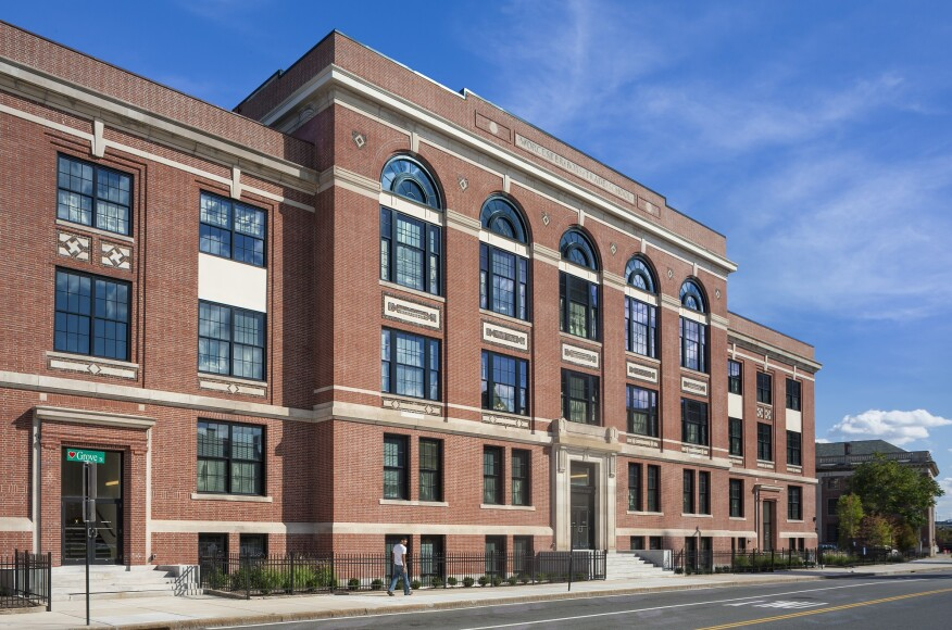 The Front Elevation At Voke Lofts Evokes Building S Scholastic Past With Stone And Red Brick