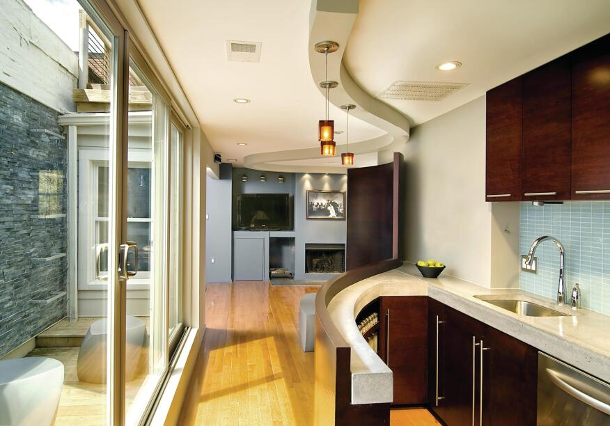 Wall To Wall Interest This Modern Row House Remodel Makes