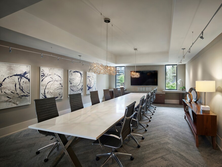"At AVE in King of Prussia, PA, residents have access to an executive conference room featuring an 82"" TV with Apple TV for Airplay, an RTI control panel and a Yealink conference phone."